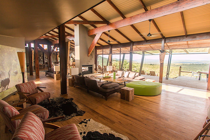 Spacious lounge with views out to the valley - photograph by Guy Upfold.