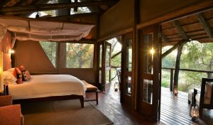Sunrise in a suite at Rhino Post Safari Lodge, Kruger National Park. Photo by Guy Upfold.
